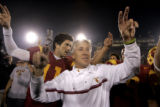 University of Southern California Trojan head coach Pete Carroll celebrates in front of the fans...