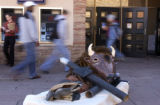 University of Colorado senior Dan Ollila (CQ), 30, who dressed in a Buffalo suit, protested CU's...