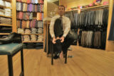 Eric Footer (cq), 39, gets a suit fitting at Triage Fashions and Accessories located at 1512...