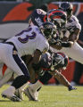 Denver Broncos punt returner Darrent Williams is brought down in the first quarter of play by...