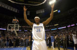 Denver, Colo., Photo taken April 12, 2004- Nuggets star rookie, Carmelo Anthony, takes in the...