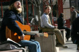 Musician Adrian Alexander, cq, 25, left, of Denver, plays an Alvarez acoustic guitar that he...