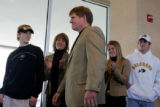 Dan Hawkins, surrounded by his wife and children, is introduced at a press conference in the Byron...
