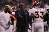 JPM1124 -- Denver Broncos runningbacks coach Bobby Turner, with back Tatum Bell, left, after Ron...