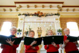 Covenant Village of Colorado Retirement Center singers perform Christmas carols before the annual...