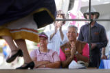 Ron Hughes (cq, right in vest and pink polo) applauds as he and his wife, Lorraine (cq, left in...