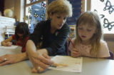 (LAKEWOOD, Colo., May 4, 2004) Mrs. Joann Campbell works with Abby Hammer on subtraction...
