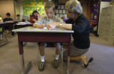 (LAKEWOOD, Colo., May 4, 2004) Garret Wilkes gets math help from Mrs. Joann Campbell individually...