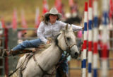 C.J. Vondette, of Rifle, competess in pole bending at the Colorado State High School Rodeo Finals...