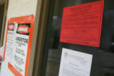 Signs posted ordering residents to evacuate are posted outside of building B at Highland Terrace...