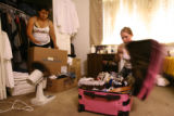 Rosa Locia (cq), left, gets help from her friend Amanda Galant (cq), right, of Denver, as she...