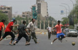 (NYT1) BAGHDAD, Iraq -- June 9, 2006 -- IRAQ-1 -- Taking advantage of a curfew imposed on traffic...