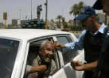 (NYT2) BAGHDAD, Iraq -- June 9, 2006 -- IRAQ-2 -- A motorists argues with Iraqi policemen after...