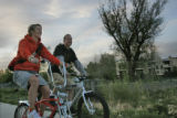 Dana and Kirk Derichsweiler share the bike path on Boulder's Thursday Cruiser Ride on 6/11/06....