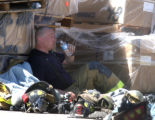 Aurora firefighter Joseph Fitzgerald (cq) drinks water after retreating from a magnesium fire at...