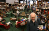 Paul Epstein, owner of the music store, Twist & Shout, browses through books in the former...
