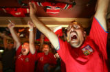 Czech Republic fan Marek Kuzela (cq), right, of Denver, cheers as the Czech Republic scores their...