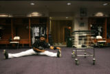 Luis Gonzalez (cq) stretches out in the Rockies clubhouse before the game against Houston Friday,...