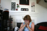 Debbie Gomnes(cq) becomes emotional while talking about her friend and roommate Kathy DeBell(cq)...