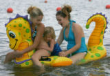 DRAGONS AND AUNTS:::::::Mikayla Fisch, CQ, 4, center, holds on as her aunts Brittany Harms,CQ, 17,...