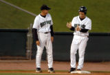 Sky Sox Manager Tom Runnels, left to right, shares a laugh with Kaz Matsui at third base during...
