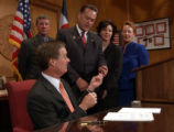 (Denver, Colo., April 19, 2004)  Gov. Bill Owens hands a pen to State Rep. Dale Hall (R-Greeley),...