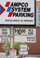 A parking lot at 15th Avenue and Tremont Place advertises a 10$ a day rate for parking while a...