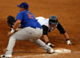 Drillers' Troy Tulowitzki (2) slides back to first safely as Midlansd's Brant Colamarino (27)...