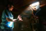 Henry Wilen (cq, left), 10, of Palo Alto, Ca. catches a ray of light in his hands inside a kiva at...