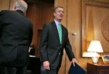 Colorado Governor Bill Owens walks in to his offices to meet with the media at a press conference...