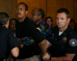 Marcus Richardson Sr. is restrained for becoming aggressive towards the media as he leaves a...