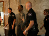 Marcus Richardson is escorted out of the courtroom by Denver Sheriff deputies Wednesday June 14,...
