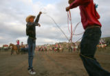 Ryan Hinton, of Leadville, left, practices his roping skills with Ty Ingo, of Pueblo, right,...