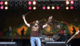 (L-R)  Ryan Shupe, of the Ryan Shupe and the Rubberband, belts out the tunes and p[lays the...
