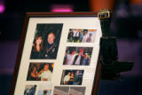 A frame containing a number of family photos and the empty belt and holster of Denver Police...