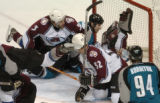(San Jose, Ca., April 22, 2004)  Colorado Avalanche goalie #1, David Aebischer reaches up in vain...