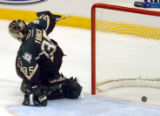 (DALLAS, TX., APRIL 14, 2004)  FILE GAME 4 AVS-STARS:The puck rebound out of the net after...