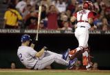 Los Angeles Angels of Anaheim vs. the Los Angeles Dodgers--Dodgers' Jeff Kent tosses his bat after...