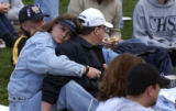 (DENVER, Colo., Shot on 4/20/04) -- An unidentified woman hugs a man at a rememberance service at...