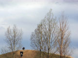 (DENVER, Colo., Shot on 4/20/04) -- People stroll atop Rebel HIll prior to a rememberance service...