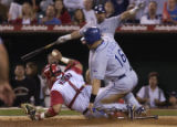 Anaheim Angels vs. Los Angeles Dodgers-6-28-03-Angel catcher Bengie hangs onto the ball as Paul Lo...