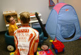 KAS078 University of Texas student Megan Currin (cq), right, talks with Jakob Ratliff, 4, of...