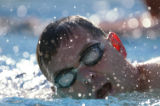 KAS232 A swimmer comes up for breath during the second day of 24-4-Molly at Skyline Acres Pool on...