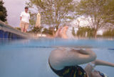 KAS326 A swimmer turns around underwater while John Wilder (cq) watches the participants at a...