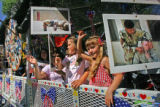 (NO ID's) Families crowd a float that was decorated to honor the men an women serving in the armed...
