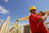 Chris Duarte (cq) hauls lumber while working on a condominium near Loveland, Colo., on Monday,...