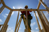 Chris Duarte (cq) builds a wall on a new condominium near Loveland, Colo., on Monday, June 20,...