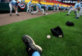 The North Carolina Tar Heel baseball team stretches before taking to the field at Rosenblatt...