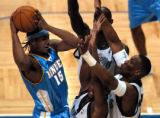 (Minneapolis,CO - Shot on 4/21/04)  The Denver Nuggets' Carmelo Anthony (#15) is triple teamed by...