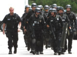 Loveland and Ft. Collins SWAT members walk back to their command center after sucessfully ending a...